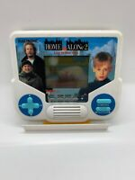 Tiger Electronics Home Alone 2 Lost in New York Handheld Video Game ~ Works Well