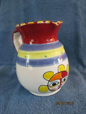 Vintage White Pitcher w/blue, yellow & red stripes - sun face on front