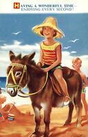 COMIC BAMFORTH HOLIDAYING GIRL CHILD at BEACH RIDING a DONKEY POSTCARD UNUSED