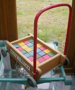 Vintage wooden baby walker with coloured wooden bricks