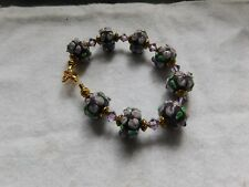 Purple flower lampwork rondelle beads with crystal bracelet
