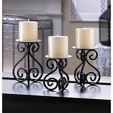 scrollwork black pillar candle stands set 0f 3