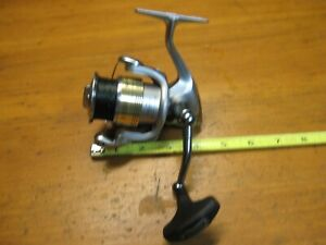 Used Shimano Stradic 3000 fl.Comes with braided line,9.6 ounces.