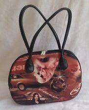 Handbag brown/red print with black handles and black zip.