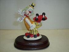 Clown on roller skates Hand Painted Porcelain on Wood Oval Base