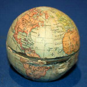 An antique globe form travelling inkwell, Vienna made, good condition