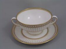 WEDGWOOD COLONNADE GOLD TWO HANDLED SOUP COUPE AND SAUCER.