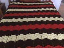Afghan.  5ft. x6ft.  Red, dark brown and white.
