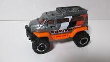 Loose mint Matchbox 2013?  VANTOM  4x4 van silver & orange
