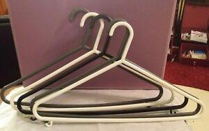 Set of 5 Plastic Coat Hangers (2 x White, 2 x Grey and 1 x Black)