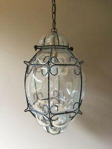 Vintage caged blown glass lantern