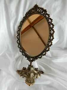 Lovely Oval Shaped Mirror on an Ornate Metal Stand