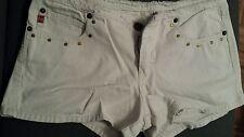 White denim frayed waist shorts with gold stud detail. Size 9