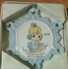 1995 Enesco Precious moments ornament. 'He covers the earth with his beauty'