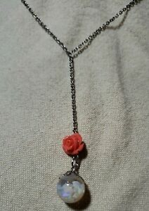 #656 floating opal necklace with faux coral rose.