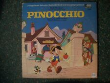 PINOCCHIO---WALT DISNEY VINYL ALBUM AND READ ALONG BOOKLET,