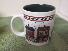 Winter Houses with falling snow flakes trimmed w/ Holly Leaves mug green inside