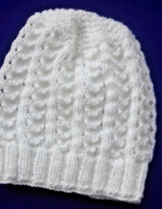 A  Cream Hand Knitted Toddlers Beanie hat in DK yarn