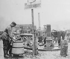 German soldier refilling water canteens Lodz Poland 1914 World War I 8x10 Photo