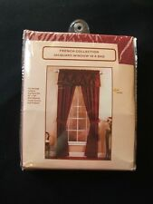Brand New  pkg pair curtains, tiebacks and beaded attached valance burgundy50x84