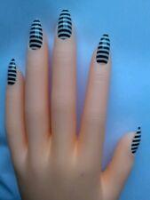 Full cover fake nails, stiletto, pointy, claw. Black and white stripes. Jailbird