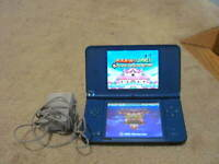 Blue Nintendo DSi XL with Charger,stylus & 5 Games -MARIO GAME--COSMETIC DAMGE