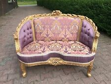 French Louis XVI Style Sofa Upholstered with Damask Fabric.