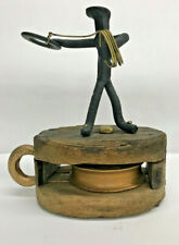 "Vintage metal sculpture on a wooden ship block "" The Cowboy """