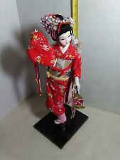 Vintage Japanese Geisha girl doll figurine on wooden base