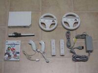 Nintendo Wii Konsole weiß + Mario Kart + 2x Remote + Nunchuk + 2 Lenkräder