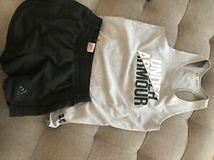 girls black adidas shorts and grey under armour singlet