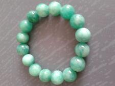 Bracelet en jade vert foncé, 1 rang, diamètre perles 12mm, extensible.