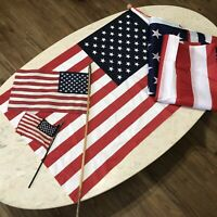 Lot of 4 American Flags 50 Star 2 Handheld 1Large 3' x 5' and dowel hanging one