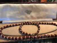 Vintage Art Deco Burgundy Glass Hand Strung Graduated and Faceted Necklace