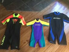 Three Shorty Wetsuits:  O'Brien (size large), Gladiator (large and 12)