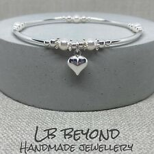 STERLING SILVER BEADED STRETCH BRACELET WITH SWAROVSKI PEARLS & HEART CHARM