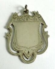 A VINTAGE 1906 CHESTER HALLMARKED SILVER WATCH FOB WITH SHIELD DESIGN