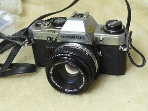 Olympus OM-10 SLR FILM CAMERA W/ Genuine 50mm F/1.8 Lens WORKING + filter OM10 r