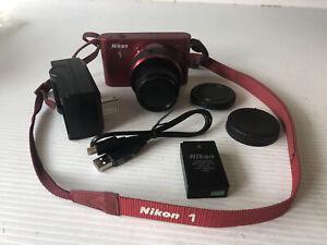 Nikon 1, J1, 10.1MP Digital Camera,Red w/ VR 10-30 Lens and more.