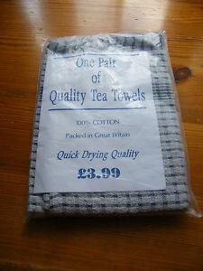 pair of vintage new unused cotton tea towels  in wrapper