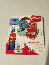 VANCOUVER 2010 OLYMPIC COCO COLA SPONSOR-QUATCHI SPEED SKAT PIN-ON ORIGINAL CARD