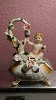 Vintage1930's Ucagco Porcelain Hand Painted Japan Figural child on Vase Flowers