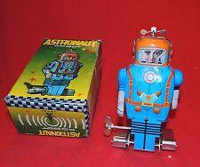 Robot. en tôle sérigraphiée. ASTRONAUT ROBOT bleu et orange hauteur 14 cm - Neuf