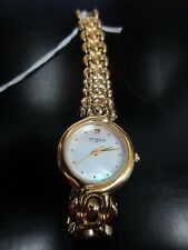 WITTNAUER LADIES MOTHER OF PEARL FACE, GOLD TONE BAND, USED