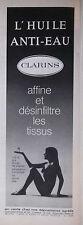PUBLICITÉ DE PRESSE 1970 - L'HUILE ANTI-EAU CLARINS - SEINS NUS - ADVERTISING