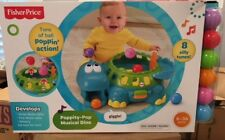 Fisher-Price Poppity-Pop Musical  Dino baby toy Blue Dino Minor creasing on box