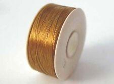 beading thread - one spool of GOLD nymo B