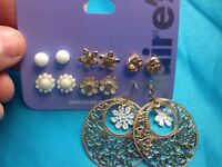 Six Pairs Of Claire's Gold Tone And White Large Dangling Flowers Earrings