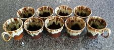 Hull China 9 piece lot of brown drip cups and mugs.
