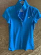 HOLLISTER LADIES TURQUOISE SHORT SLEEVED POLO TOP SIZE SMALL